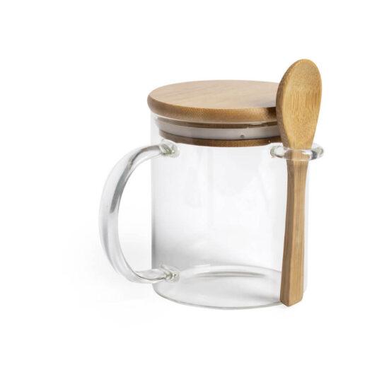 caneca de vidro com tampa e colher de bambu