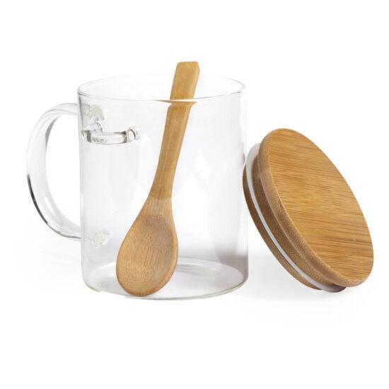 caneca de vidro aberta com tampa e colher de bambu
